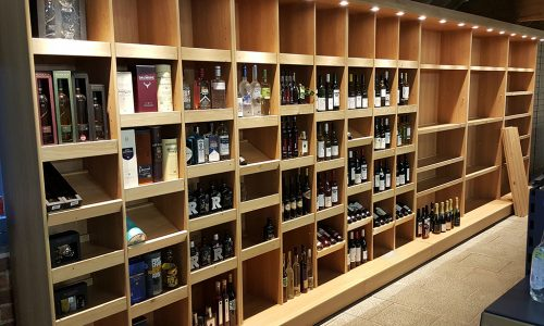 Wall unit with adjustable shelving for wine display