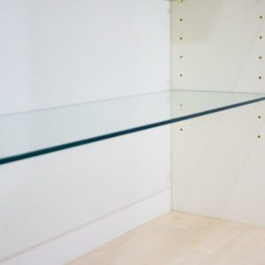 Adjustable glass shelving